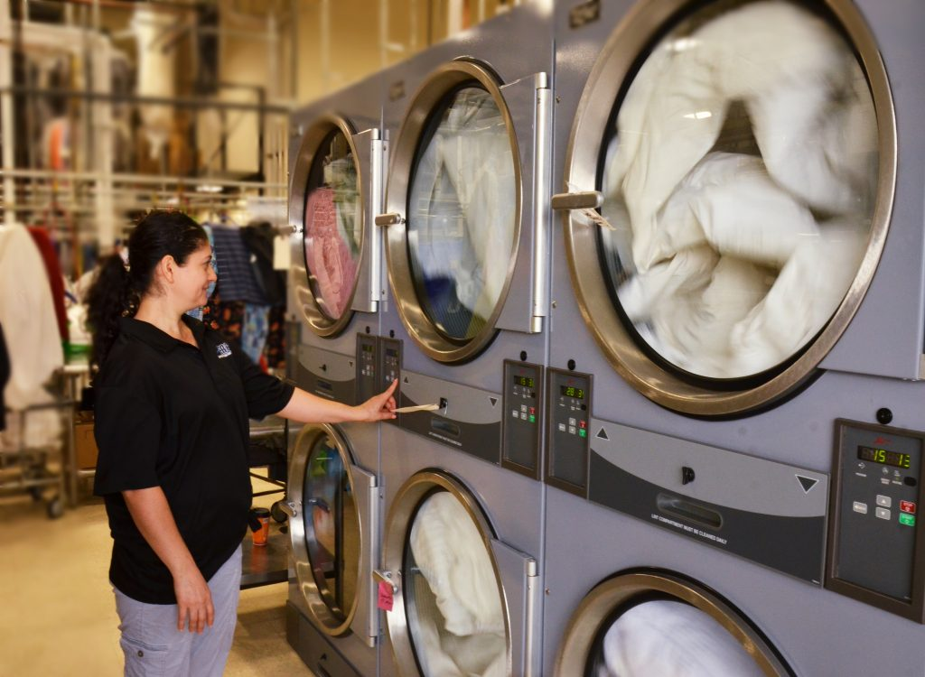 Women Using a Commercial Dryer at a Laundromat Provided by Metropolitan Machinery